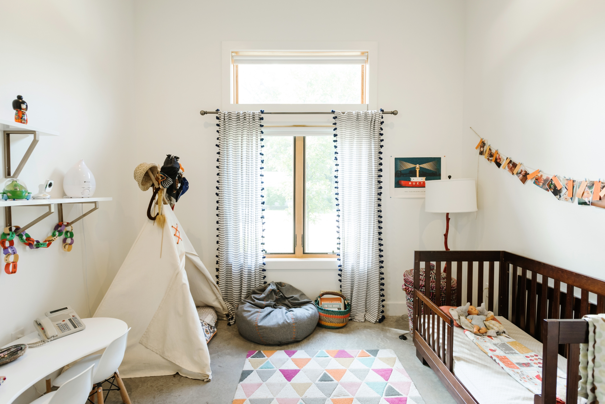 A family friendly home in Austin showing a room with a cot, toys and a teepee for young children